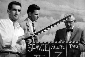 Old black and white movie scene image with three men