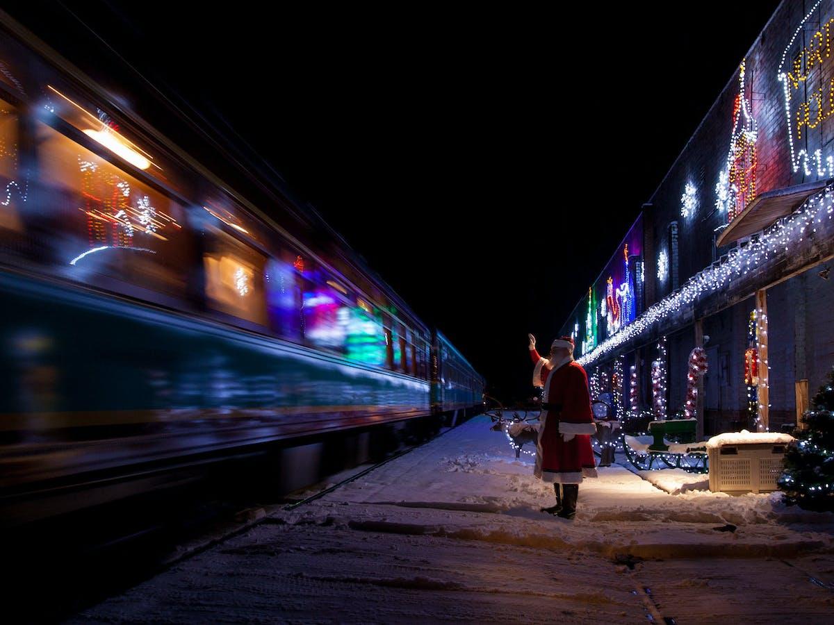 santa waving at train