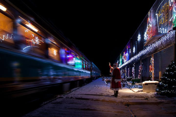 santa waving at train