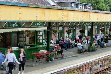 people eating at train station