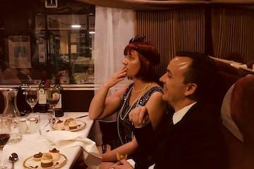couple on murder mystery train