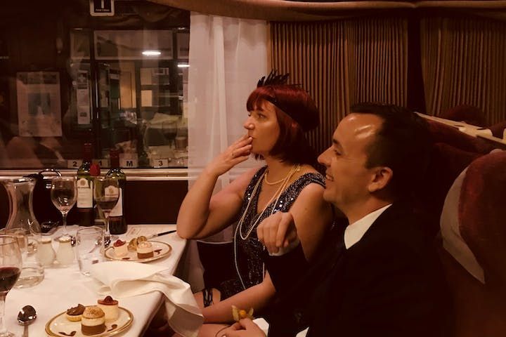 couple on murder mystery train