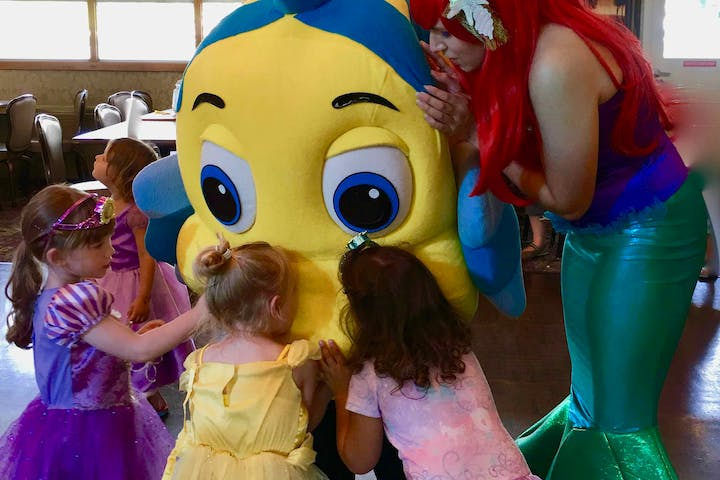 flounder and little mermaid with little girls dressed as princesses