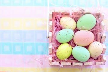 painted easter eggs in basket