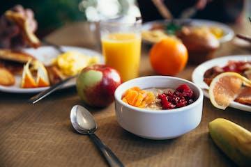 breakfast food with fruit and orange juice