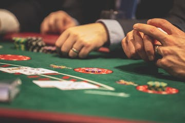 close up of card game on casino table