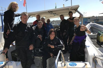 A group fo divers in a boat