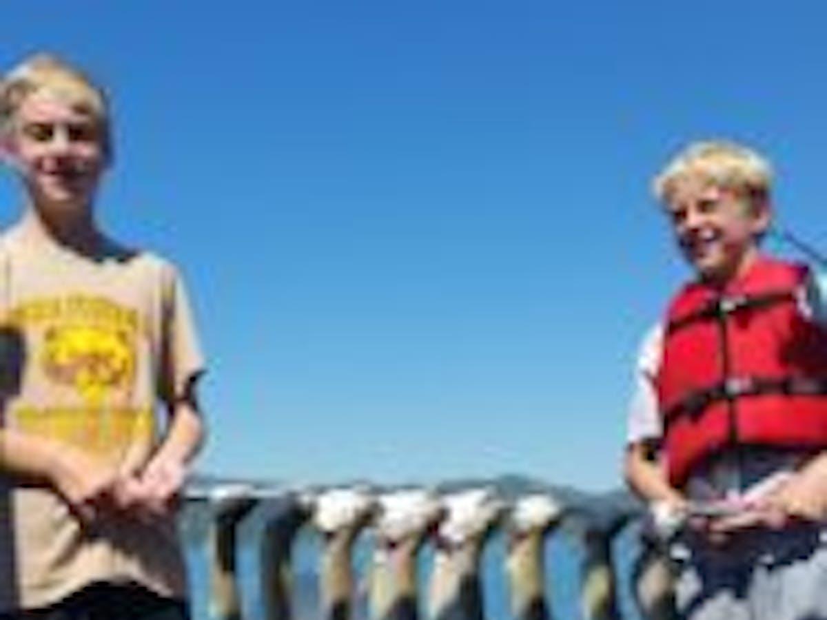 2 boys holding fish