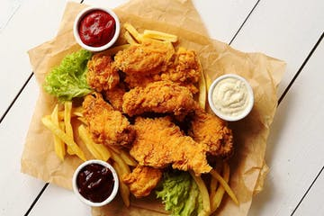 Fried chicken strips with fries