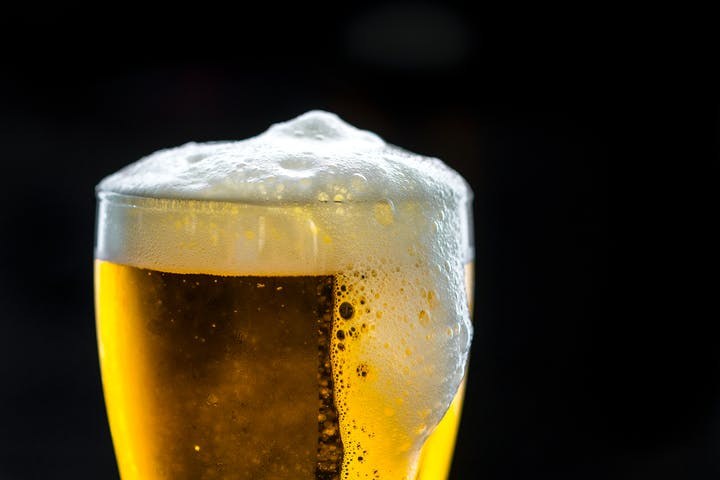 Glass of beer with a little foam on top