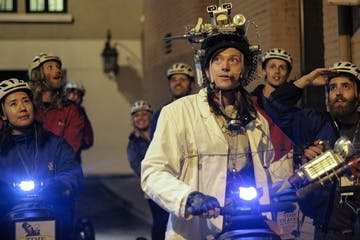 Our guide dressed in Back to Future costume riding a Segway and leading guests with wonder in their eyes