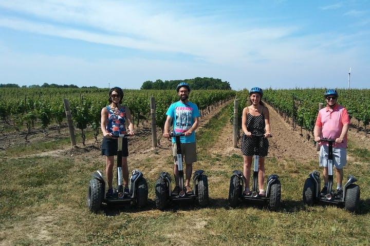 People in vineyard on segways