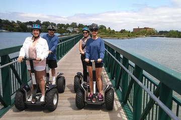Group of people on Segways on a bridge