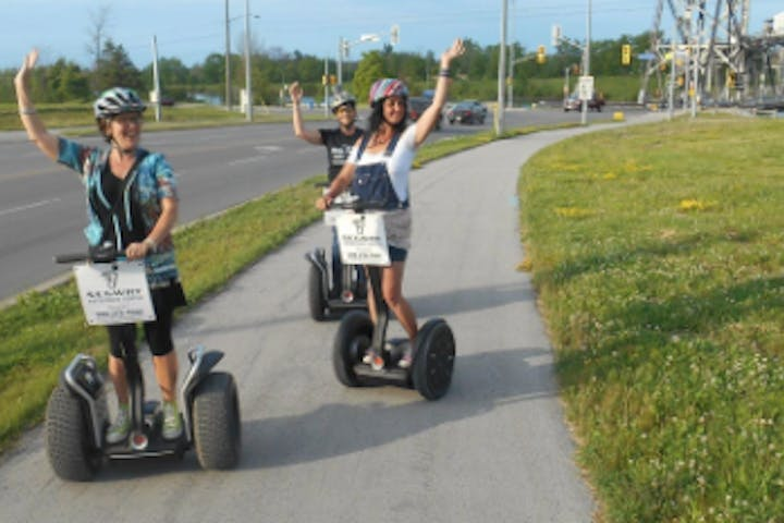 Segway riders waving