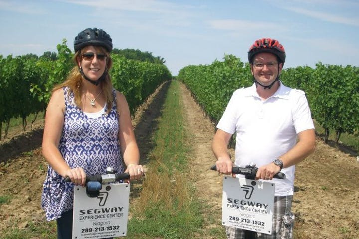 Couple on segways in vineyard