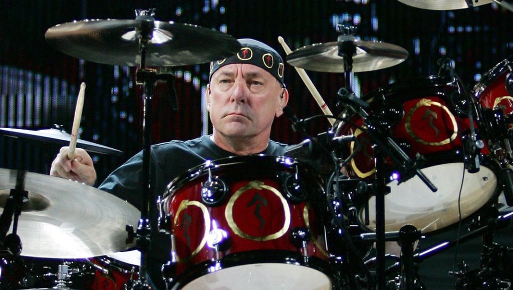 Neil Peart sitting on a motorcycle