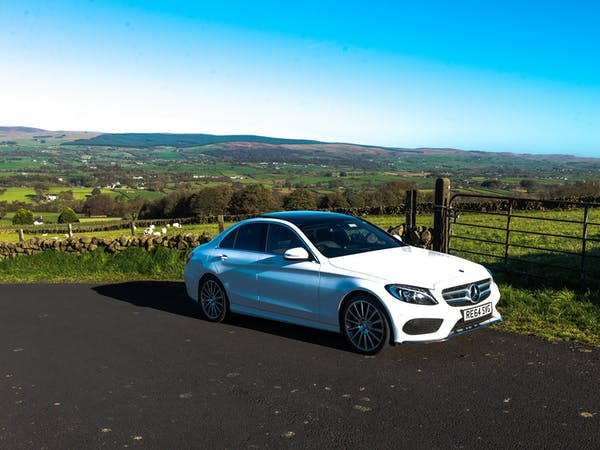 Luxury Mercedes Benz car driving in countryside
