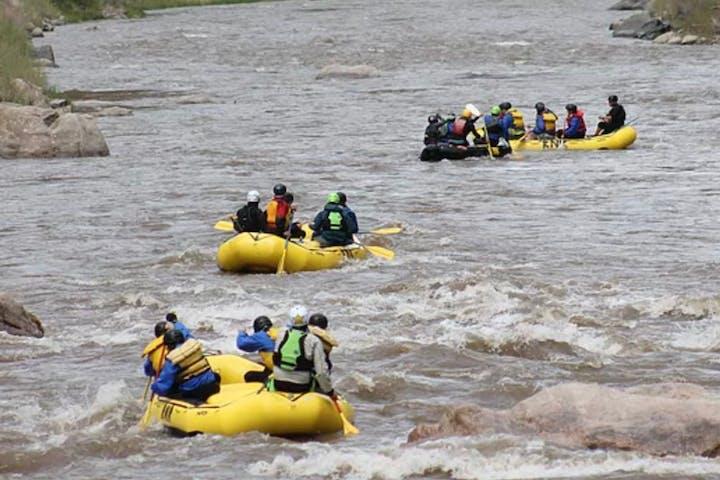 Three rafts on small rapids