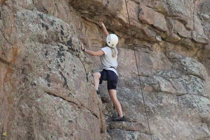 A rock climber finding grips