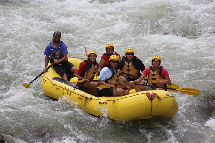 Rafters pausing for a photo on the river