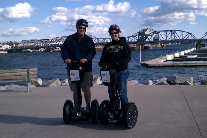 Couple on Segways by the Bay