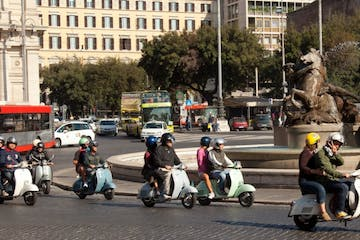 vespas with guides