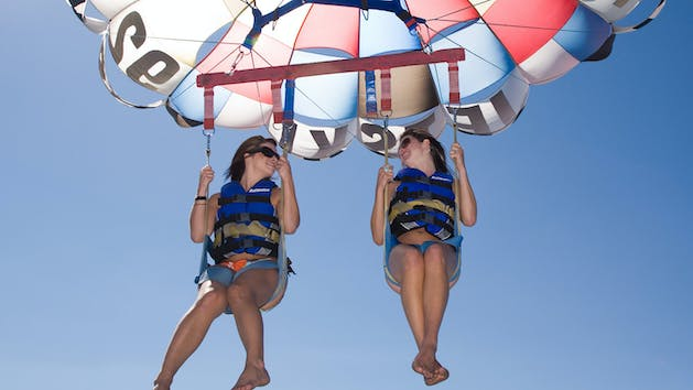 Two women parasailing in Lake Tahoe