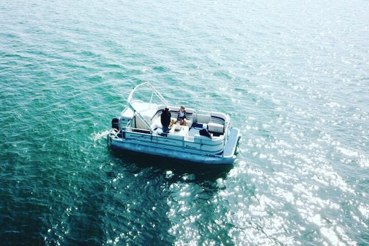 aerial view of pontoon boat in water