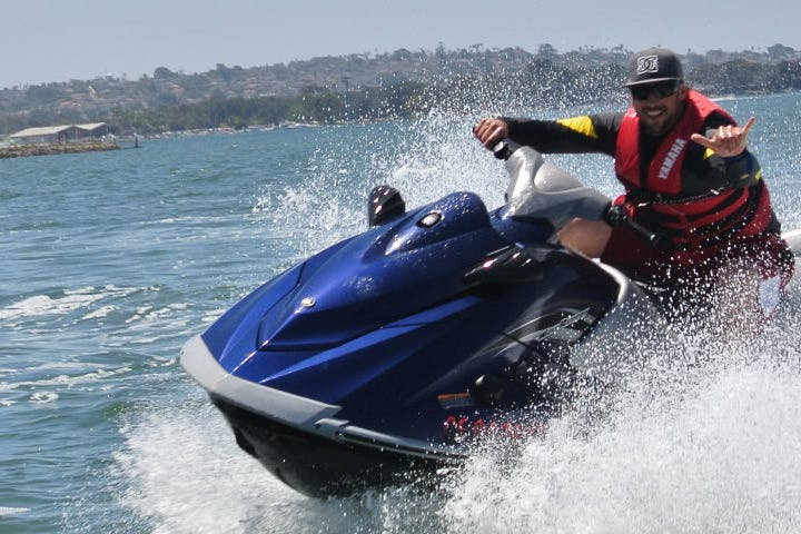 jet skier riding fast on the water