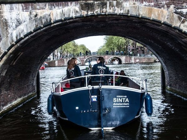 Open Boat sailing the canals of Amsterdam