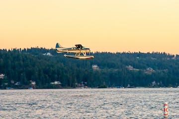 Plane Landing on the lake at sunset