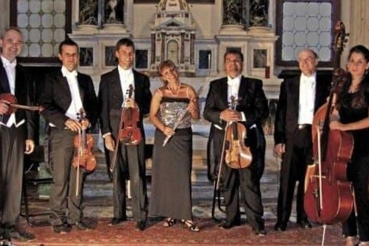 Orchestra members with instruments