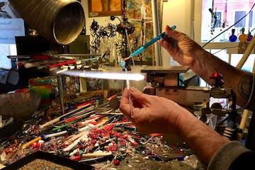 Glass artisan making a glass piece