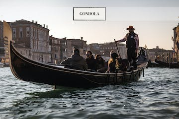 a group of people on a boat in the water