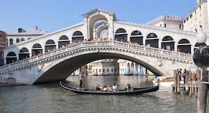 a boat sitting on top of Rialto Bridge