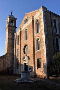 a large brick building with a clock tower