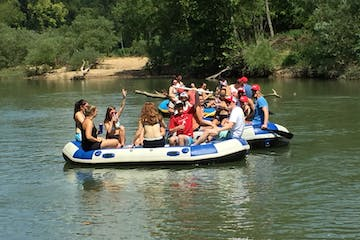 Three groups of people enjoying a cooler float on the Meramec River