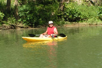 A older man in a kayak on the Meramec River