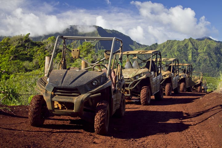 row of 4x4 atvs with mountains