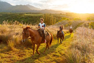 group riding horses in scenery