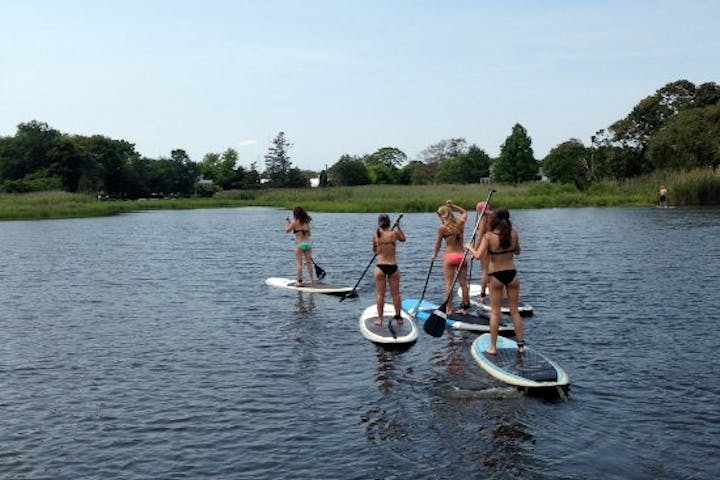 group of moms on stand up paddleboards