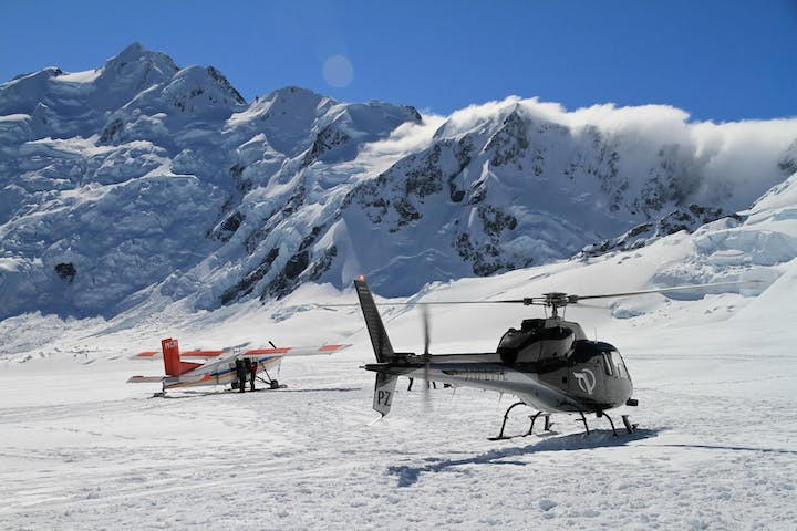 Ski plane and helicopter lands on mt cook