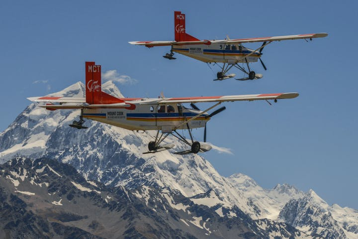 2 ski planes flying over Mt Cook in New Zealand