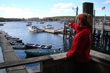 Little girl pointing at harbor from deck