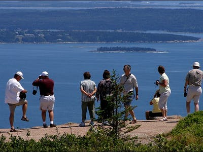 Group of people standing on lookout in Acadia National Park
