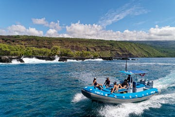 People riding on snorkel boat in Hawaii