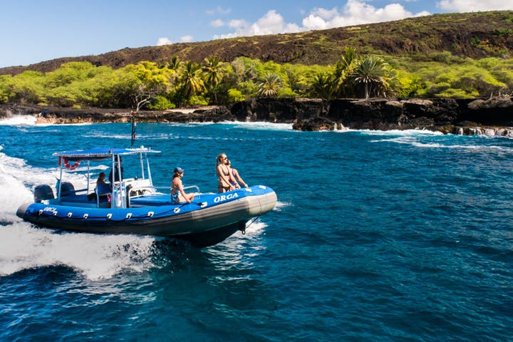 People riding in blue dive boat