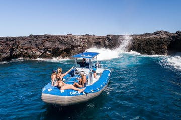 Group of snorkelers riding in blue dive boat