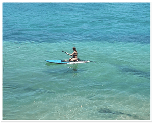 Girl on paddle board