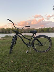 a bicycle parked in a grassy field
